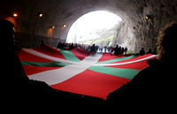 Protesters carry Basque flag